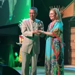 Wong, receiving his award from ICCA President Nina Freysen-Pretorius in November at the 55th ICCA Congress in Kuching